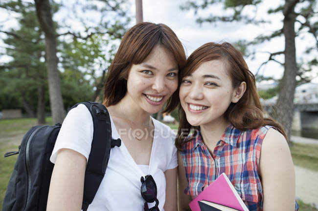 Asian Friends in the park. — Stock Photo