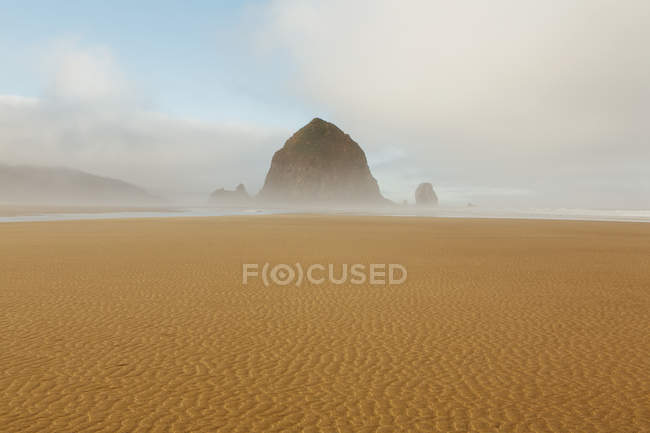Lifting fog over Haystack Rock — Stock Photo
