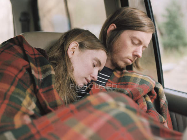 Couple taking a nap in their car — Stock Photo