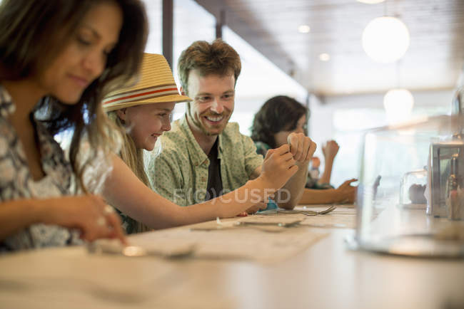 Friends sitting at the bar in a diner — Stock Photo
