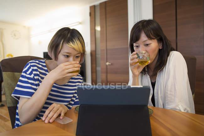Women looking at digital tablet. — Stock Photo