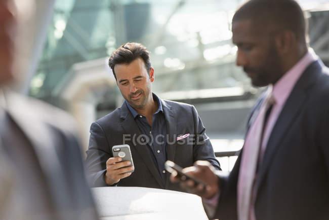 Group of three businessmen — Stock Photo