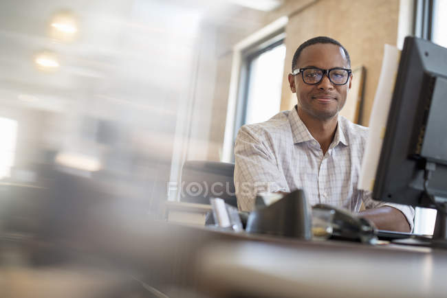 African american man using a computer. — Stock Photo