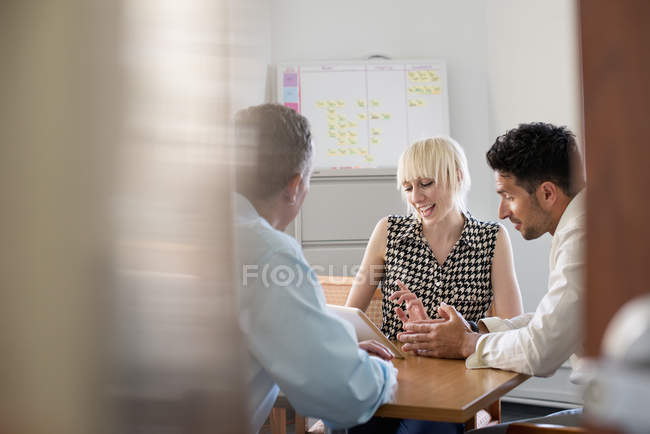 Three business colleagues in office — Stock Photo
