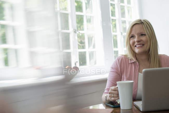 Woman using a laptop — Stock Photo