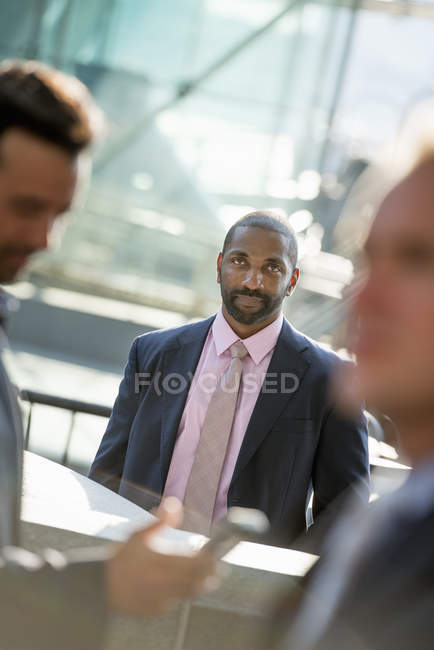 African american businessman seated looking to camera — Stock Photo