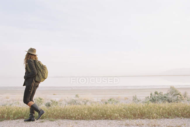 Woman walking along a country road — Stock Photo