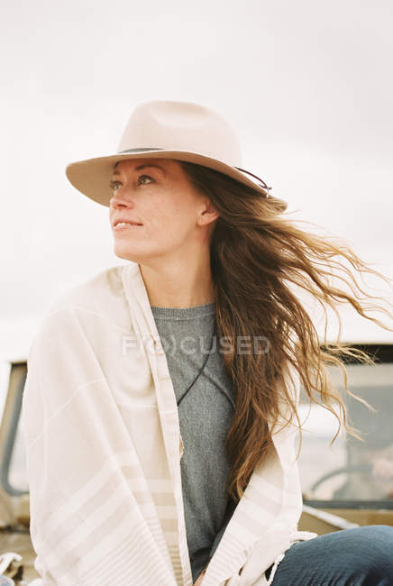 Woman wearing a hat and looking around — Stock Photo
