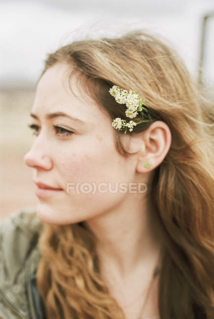 Woman with a flowers in her hair. — Stock Photo
