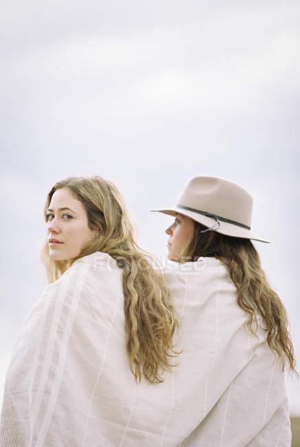 Women sitting side by side — Stock Photo