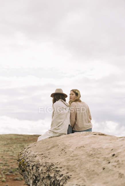 Boho women sitting side by side — Stock Photo