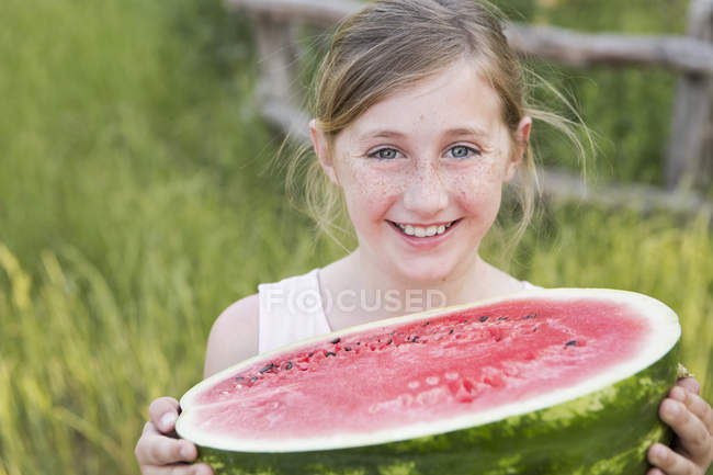 Girl holding water melon. — Stock Photo