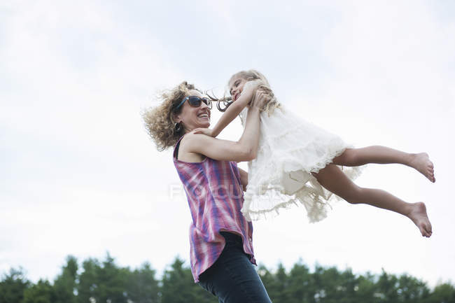 Mother playing with her daughter. — Stock Photo