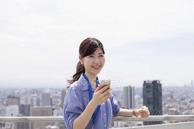 Working woman on balcony. — Stock Photo