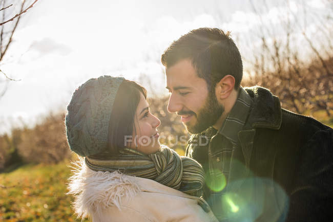 Couple walking in an orchard — Stock Photo