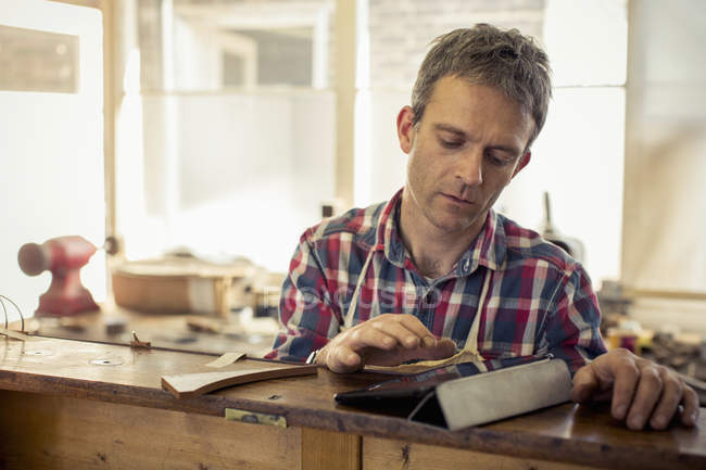 Craftsman using a digital tablet — Stock Photo