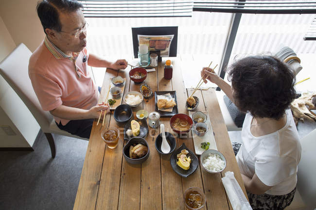 Woman and man eating Japanese Food — Stock Photo