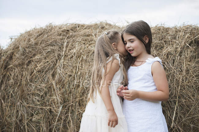 Girls sharing a secret. — Stock Photo