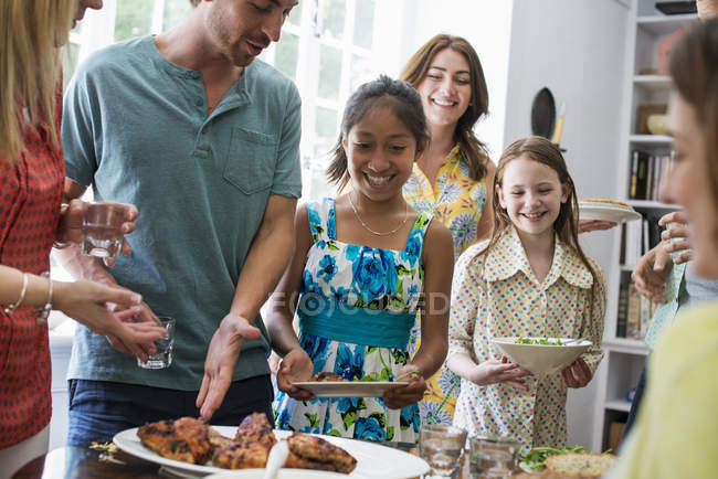 Family gathering for a meal. — Stock Photo