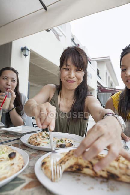 Women enjoying a meal — Stock Photo