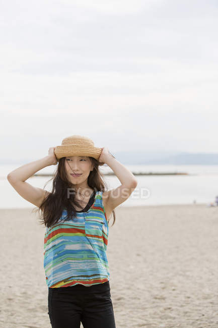 Young asian woman in hat — Stock Photo