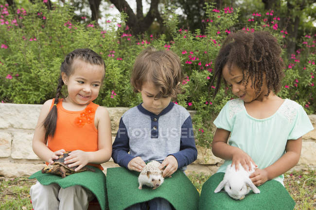 Children with a small animals — Stock Photo