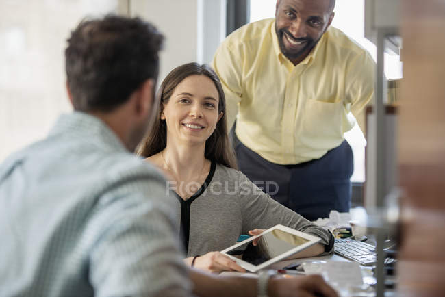 Three people in an office — Stock Photo
