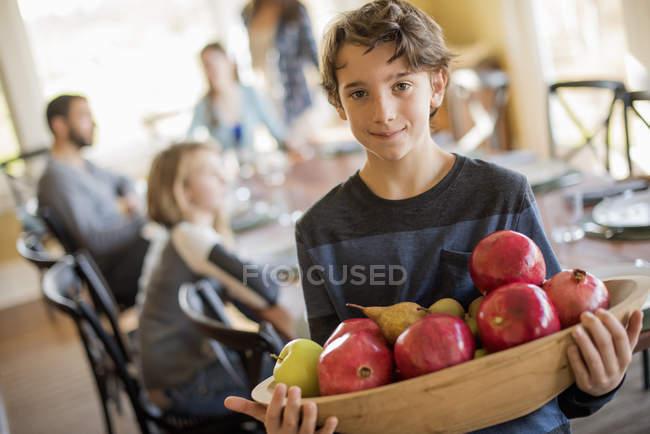 Boy carring apples — Stock Photo
