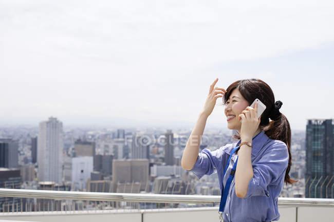Working woman on balcony — Stock Photo