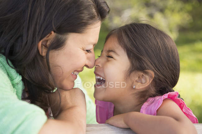 Mother in the park with her daughter — Stock Photo