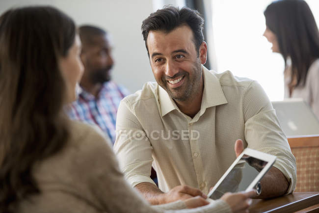 Four people in an office — Stock Photo