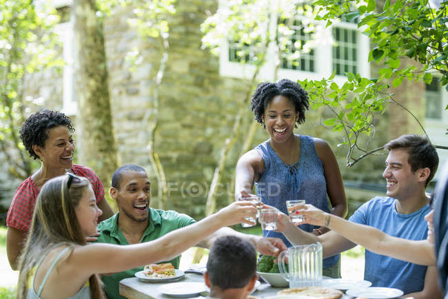 Family eating in a garden — Stock Photo