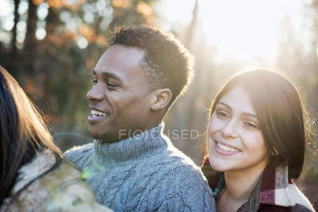 Couple standing in a sunlit forest — Stock Photo