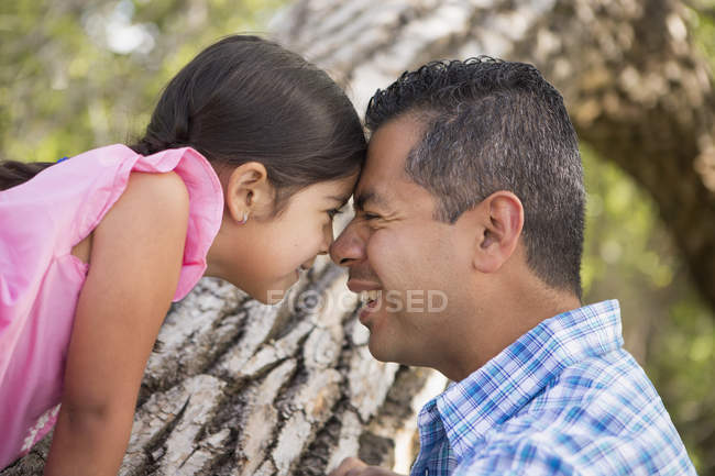 Father and daughter with foreheads pressed — Stock Photo