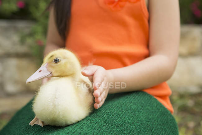 Child with a duckling — Stock Photo