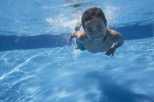 Boy swimming underwater — Stock Photo