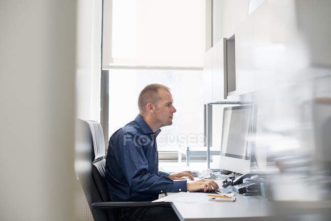 Man working in an office — Stock Photo