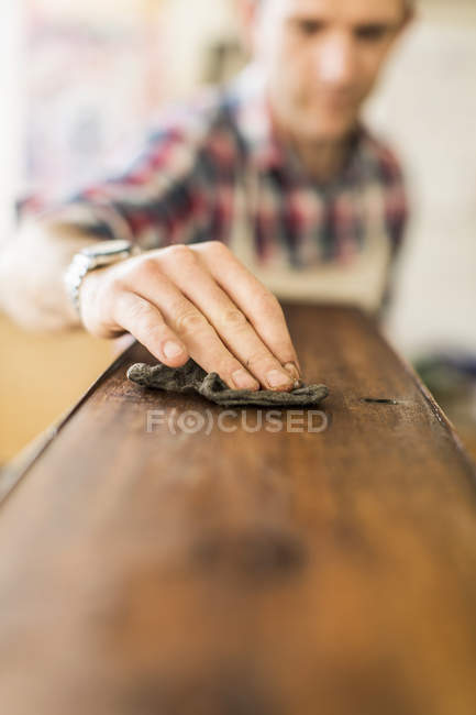Furniture restorer at work — Stock Photo