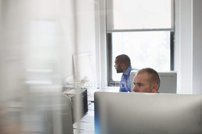 Two men working in an office — Stock Photo