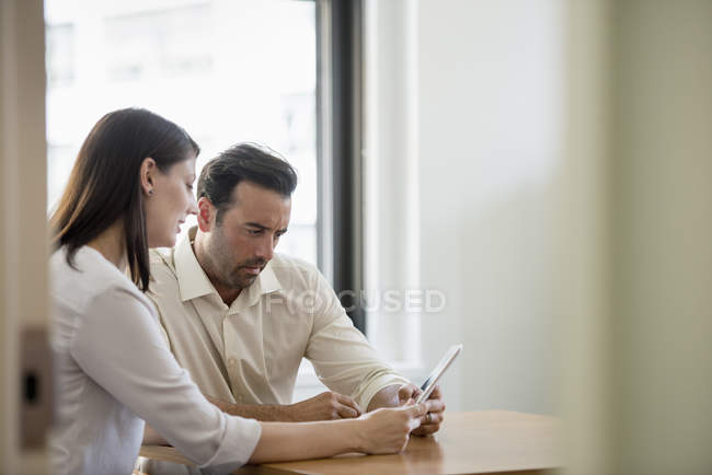Man and woman in an office — Stock Photo