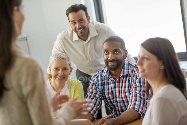 Five people in an office — Stock Photo