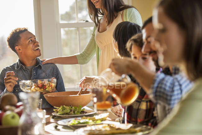 People seated around a table for a meal — Stock Photo