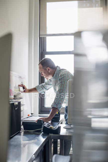 Man standing up and working — Stock Photo