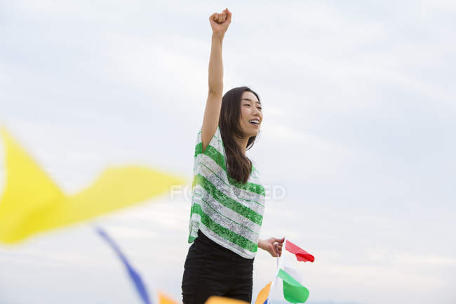 Woman hoding paper flags — Stock Photo