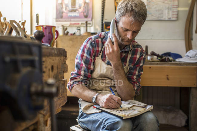 Antique furniture restorer in his workshop — Stock Photo