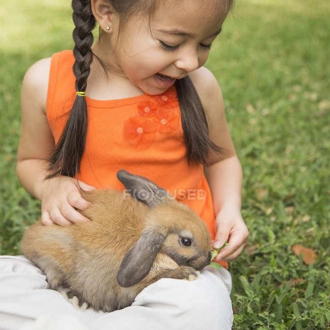 Child with a brown rabbit — Stock Photo