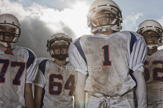 Football players in sports uniform — Stock Photo