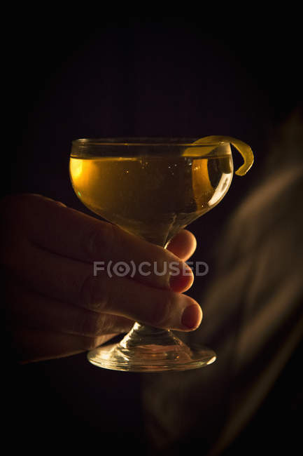 Hand holding a cocktail glass. — Stock Photo