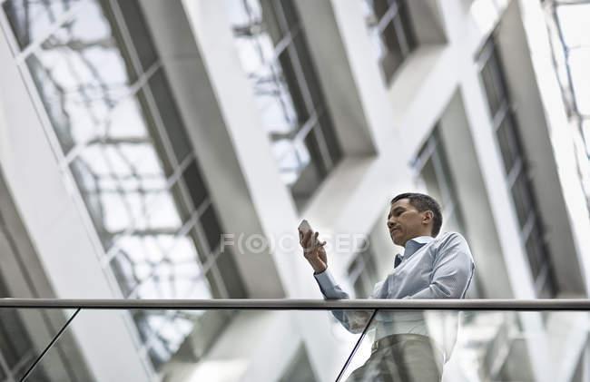 Man checking his smart phone — Stock Photo
