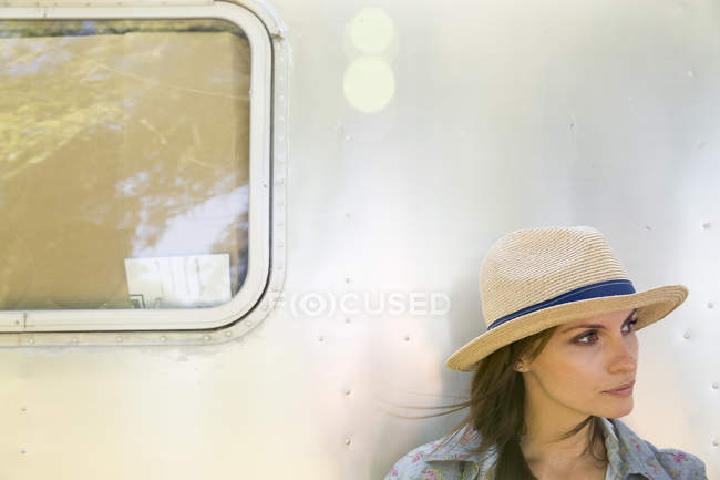 Woman sitting in the shade of trailer — Stock Photo